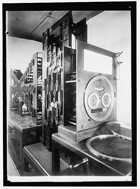 Dr. E. Lester Jones, Chief, U.S. Coast and Geodetic Survey, with the Tide Predicting Machine he built. Harris & Ewing, photographer, 1915. Retrieved from the Library of Congress, https://www.loc.gov/item/hec2008004303/